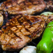 Meat steak on grill — Stock Photo #26209009