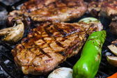 Meat steak on grill — Stock Photo