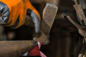 Smith forging hot iron — Stock Photo