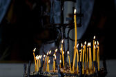 Candles lighting in church — Stock Photo