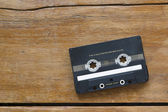 Audio cassette on wood — Stock Photo