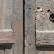 Ancient wooden door fragment — Stock Photo