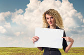 Business woman with blank poster — Stock Photo