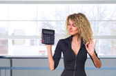 Business woman with calculator — Stock Photo