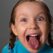 Little girl showing the tongue. — Stock Photo #13679696