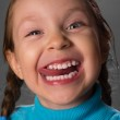 Little girl showing the tongue. — Stock Photo #13679766