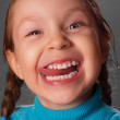 Little girl showing the tongue. — Stock Photo #13821480