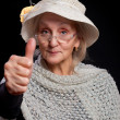 Mature woman showing thumb up — Stock Photo