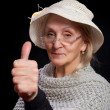 Stock Photo: Mature woman showing thumb up