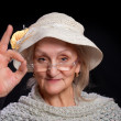 Mature woman showing sign ok — Stock Photo