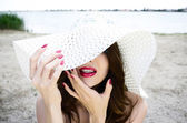 Portrait of brunette in hat — Stock Photo