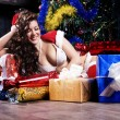 Beautiful xmass brunette as snow maiden near the new year tree a — Stock Photo