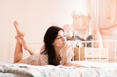 Beautiful woman in bedroom — Stock Photo