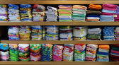 Linen cloth store shelves — Stock Photo
