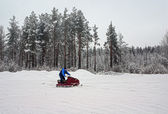 Man on a snowmobile on a skiing run. — Stock Photo