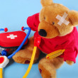 First aid box with medicines and teddy bear — Stock Photo