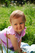 Little girl on a field — Stock Photo