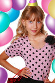 Girl on a birthday party — Stock Photo