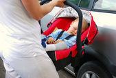 Baby sleeping in stroller — Stock Photo