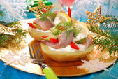 Potato with herrings and sour cream — Stock Photo