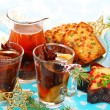 Stock Photo: Dried fruit compote and cakes for christmas