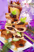 Herring canapes with prune and gherkin for christmas — Stock Photo