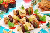 Herring skewers for christmas — Stock Photo