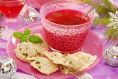 Red borscht and ravioli (pierogi) for christmas — Stock Photo