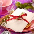 Table with christmas eve wafer on the plate with hay — Stock Photo