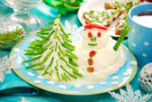 Funny christmas breakfast for child — Stock Photo
