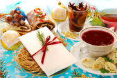 Christmas eve table with wafer and traditional dishes — Stock Photo