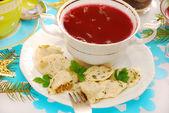 Ravioli (pierogi) and red borscht for christmas — Stock Photo