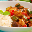 Chicken and vegetables in curry sauce with rice — Photo