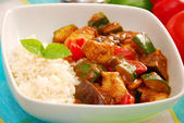 Chicken and vegetables in curry sauce with rice — Stock Photo
