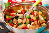 Pan with fried chicken and vegetables — Stock Photo