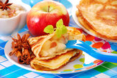 Pancake with apple and raisins for child — Stock Photo