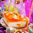 Cake with three candles on birthday party table for child — Stock Photo #13782923