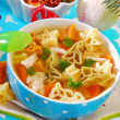 Christmas chicken soup for child — Stock Photo