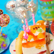 Cake with three candles on birthday party table for child — Stock Photo #14096070