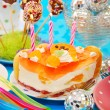 Cake with three candles on birthday party table for child — Stock Photo