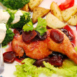 Baked chicken leg in plum sauce — Stockfoto #14328707