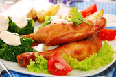 Baked chicken legs with honey — Stock Photo