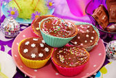 Homemade muffins on birthday party table — Stock Photo