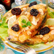 Stock Photo: Breaded carp with almonds and prune for christmas