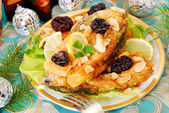Breaded carp with almonds and prune for christmas — Stock Photo