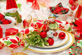 Christmas table set with snowman figurine — Stock Photo