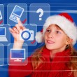 Stock Photo: Young girl choosing perfect gift for christmas