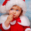 Cute baby in santa hat — Stock Photo