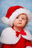 Very serious baby in santa hat — Stock Photo