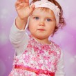 Adorable baby girl waving hand — Stock Photo